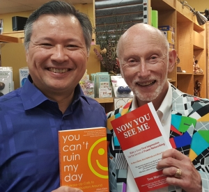 "Tom holds Allen Klein's book ""You Can't Ruin My Day"" and Allen holds Tom's Book ""Now You See Me."""