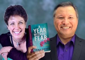 "Tom Marcoux holds Tama Kieves's book, ""A Year Without Fear"""