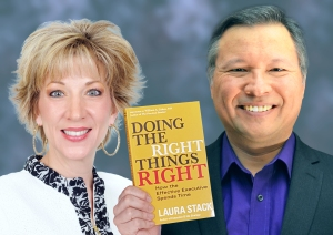 "Tom Marcoux holds Laura Stack 's book ""Doing the Right Things Right"""