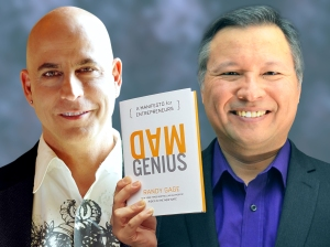 "Tom Marcoux holds Randy Gage 's book ""Mad Genius: A Manifesto for Entrepreneurs"""