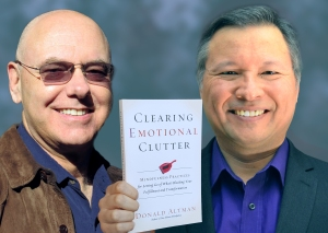 "Tom Marcoux holds Donald Altman 's book ""Clearing Emotional Clutter"""