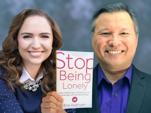 """Tom Marcoux holds Kira Asatryan 's book """"Stop Being Lonely"""""""
