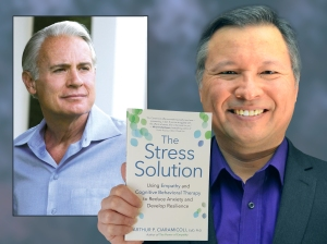 "Tom Marcoux holds Dr. Arthur Ciaramicoli 's new book ""The Stress Solution"""