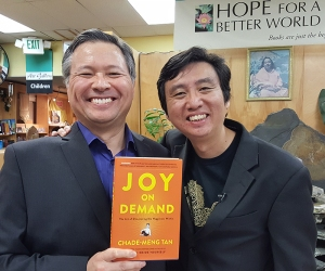 "Tom Marcoux holds Chade-Meng Tan's book ""Joy On Demand"""