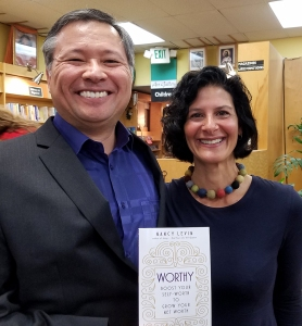 "Nancy Levin and her book ""Worthy"" -- Tom Marcoux holds a copy of the book."