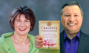 "Tom Marcoux holds Shakti Gawain 's book ""Creative Visualization, 40th Anniversary Edition"""