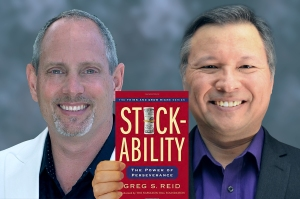 "Tom Marcoux holds Greg S. Reid 's book ""Stickability"""